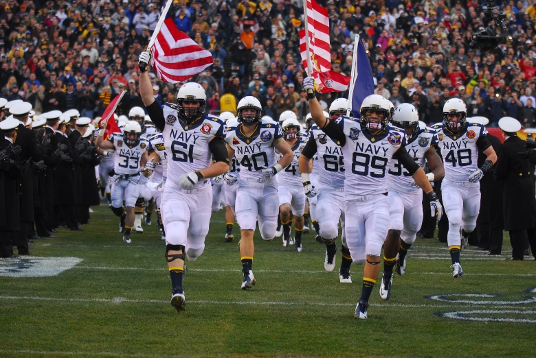 The Navy Midshipmen take the field.